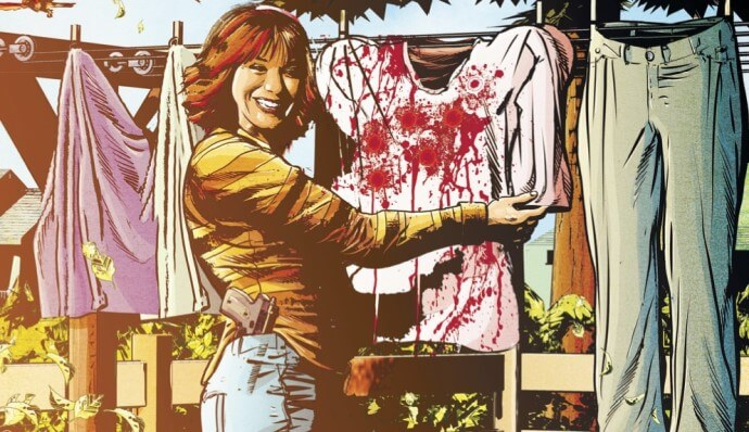 A woman smiles while putting up bloodstained laundry on a clothesline