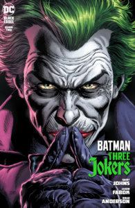 An older Joker tenting his fingers over his mouth