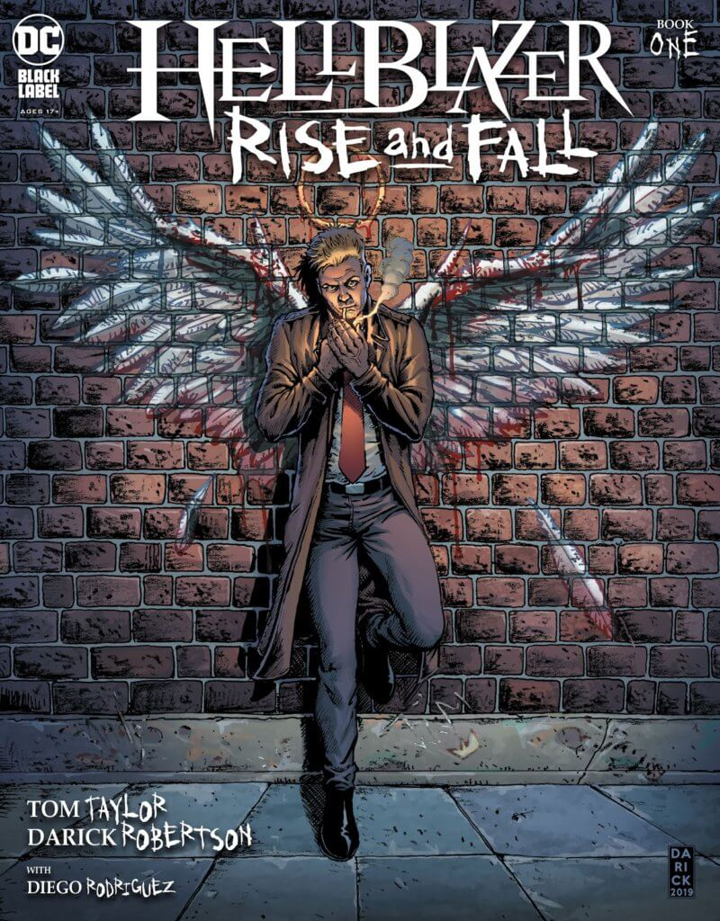 The cover of Hellblazer: Rise and Fall #1, which shows John Constantine smoking against a brick wall covered with graffiti of bloody angel wings.