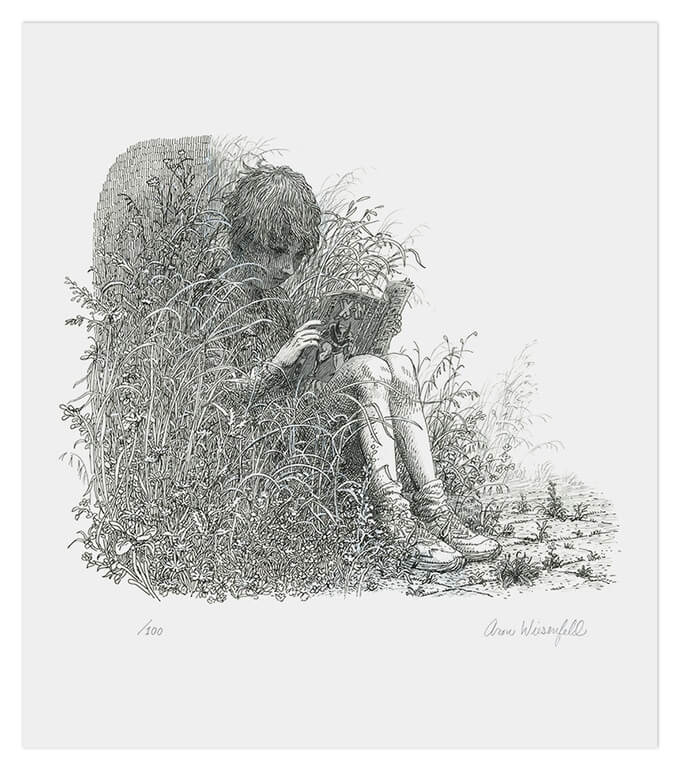 A child sitting in tall grass reading a comic with Wolverine on the back cover
