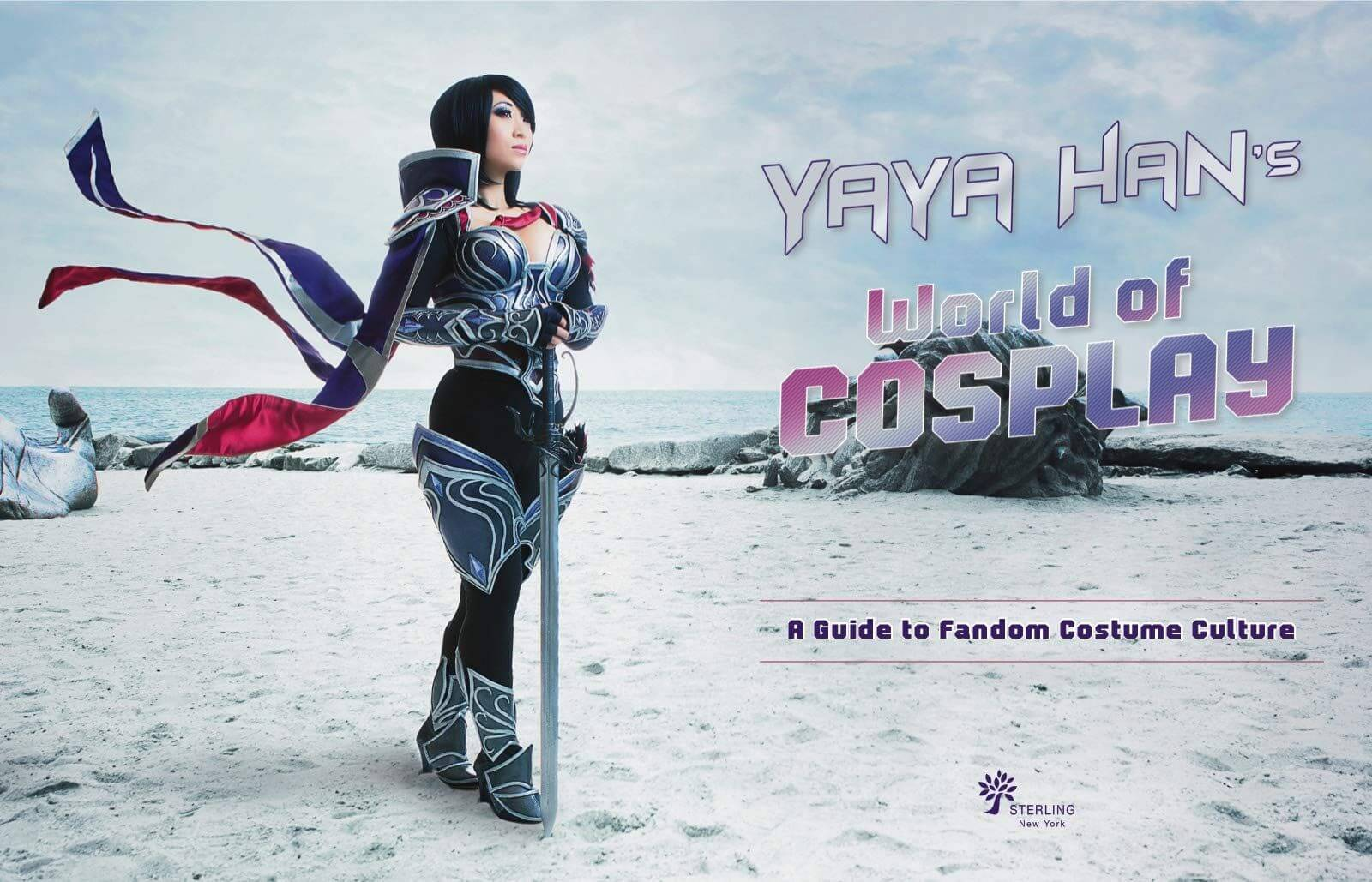 Yaya Han on a beach wearing black and silver armour in a promo image for Yaya Han's World of Cosplay