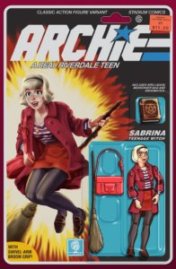 Sabrina Spellman, a teenager, sits upon her broom in a red skirt, striped scoop-neck blouse and red jacket, her red purse upon her knee. She has a blonde dutch bob held back by a black headband, and red lipstick as well as white skin. The Archie logo is drawn similarly to the GI Joe logo, and the cover has a design similar to the card backing of an action figure, complete with the character drawn as a jointed figure beneath a plastic blister bubble.