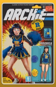 Veronica Lodge, a teenager in a blue and gold cheerleader's uniform with a black turtleneck worn beneath it, brandishes blue pom-poms, her expression determined. She has dark hair and red lipstick as well as white skin. The Archie logo is drawn similarly to the GI Joe logo, and the cover has a design similar to the card backing of an action figure, complete with the character drawn as a jointed figure beneath a plastic blister bubble.