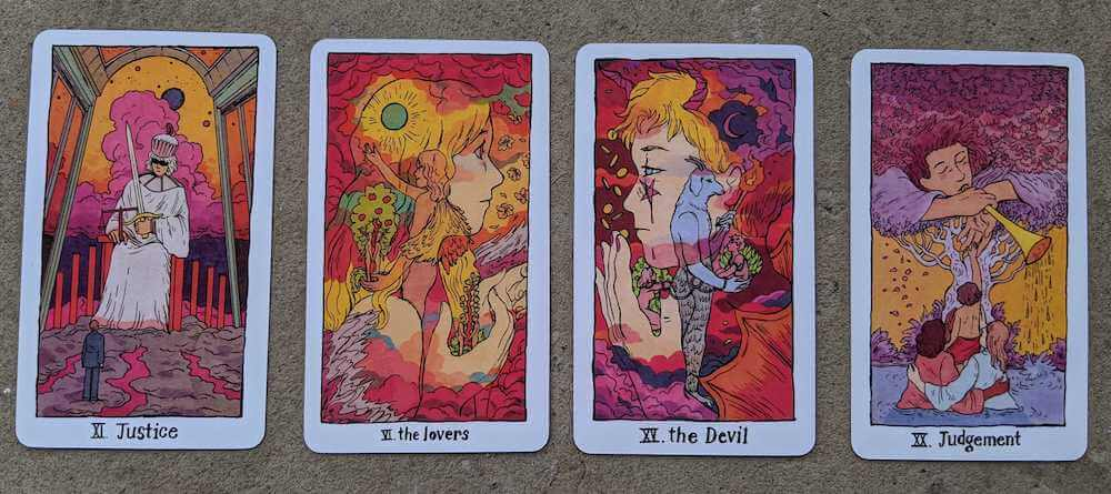 Four cards from the Cosmic Slumber deck: Justice, the Lovers, the Devil, Judgement