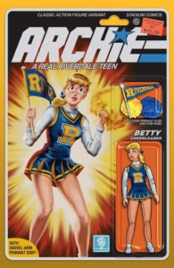 Betty Cooper, a teenager in a blue and gold cheerleader's uniform with a white turtleneck underneath, brandishes a gold megaphone and a navy and gold pennant on a stick emblazoned with the name of her high school, Riverdale. Her expression determined. She has blonde hair tied back in a ponytail with a blue bow, and red lipstick as well as white skin. The Archie logo is drawn similarly to the GI Joe logo, and the cover has a design similar to the card backing of an action figure, complete with the character drawn as a jointed figure beneath a plastic blister bubble.