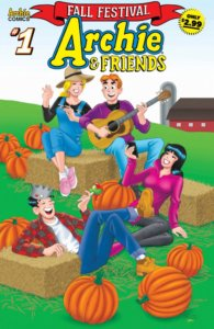 Archie Andrews, Betty Cooper, Veronica Lodge and Judghead Jones sit out on an open field near a farm and silo, propped up against bales of hay with pumpkins scattered about. Archie has his guitar and appears to be serenading the group.