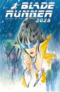 A dark haired woman with glasses pulls up the collar of her raincoat as she stands in the rain.