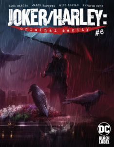 Harley in the rain under an umbrella with crows