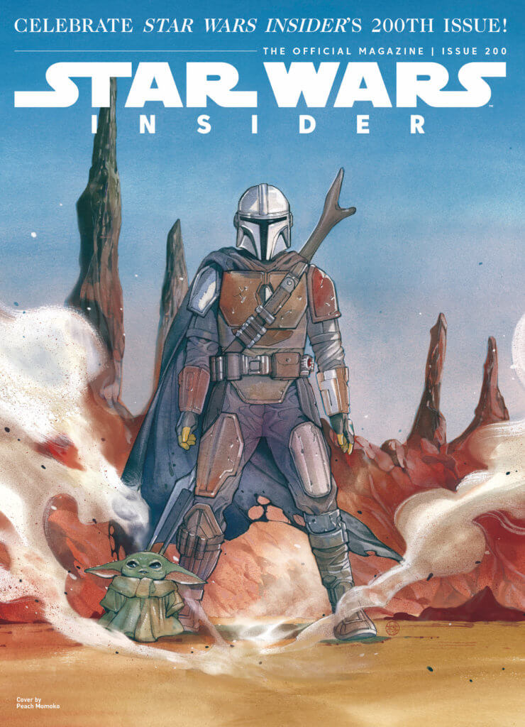 The Mandalorian and Child stand on a desert planet.