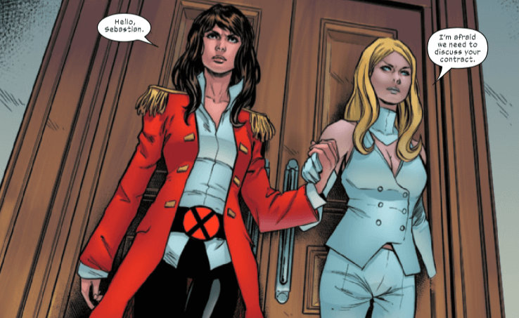 Kate and Emma walk through the door holding hands