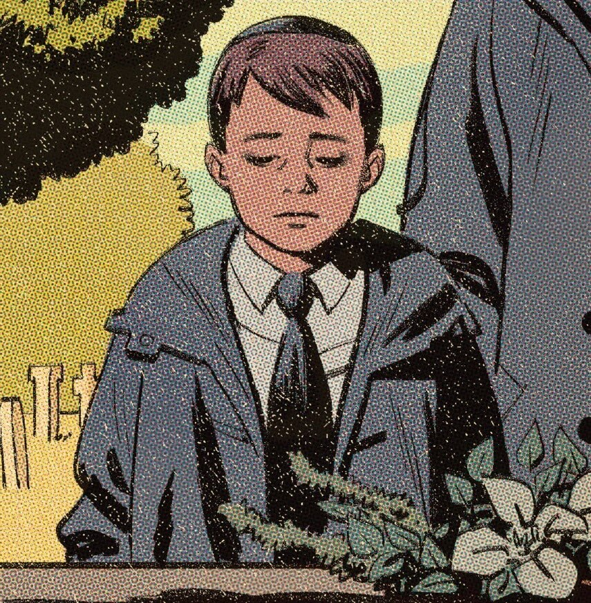 A young Ben Grimm at the funeral of one of his parents.