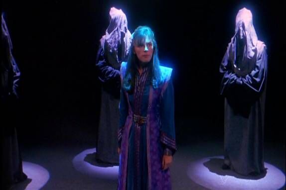 Delenn stands among the Gray Council.