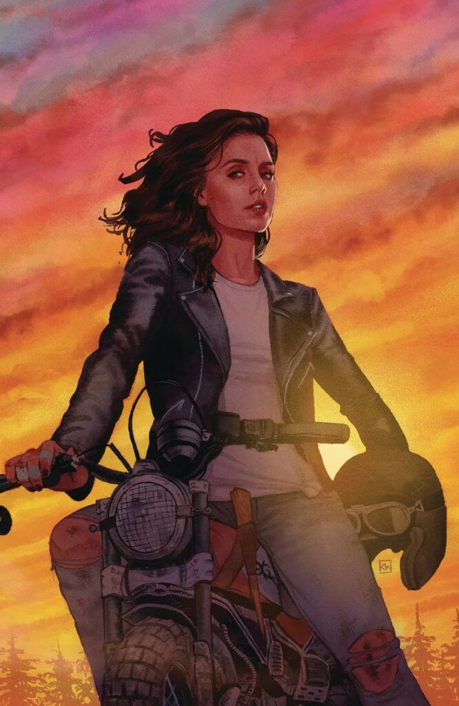 A dark haired woman sits on her motorbike under a dusky sky. Her helmet rests against her hip and a wooden stake is visible near her crotch