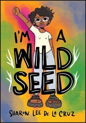 A person with brown skin, glasses, and short curly hair raises their right fist to the sky on the cover of I'm a Wild Seed by Sharon de la Cruz