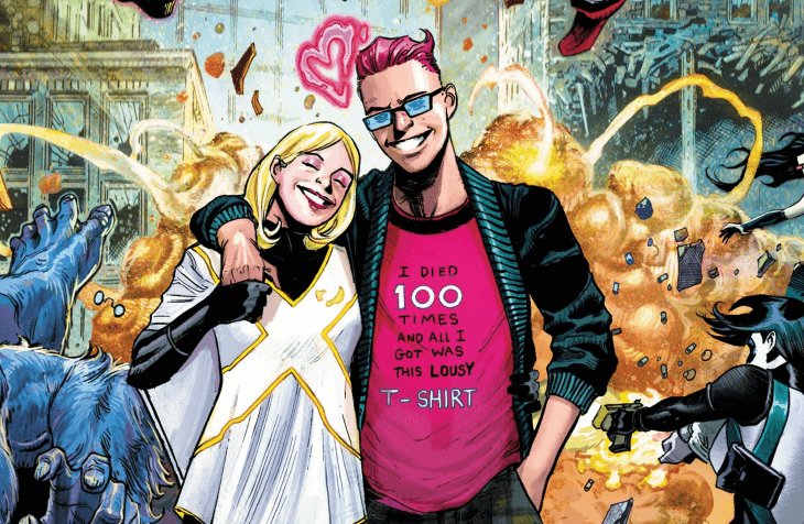 Quentin Quire with his arm around Sophie. They both smile as chaos ensues behind them