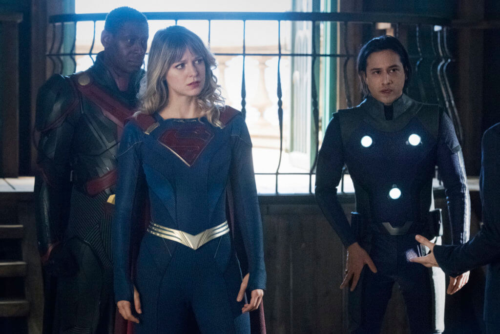 J'onn, Supergirl and Brainy look at something off camera
