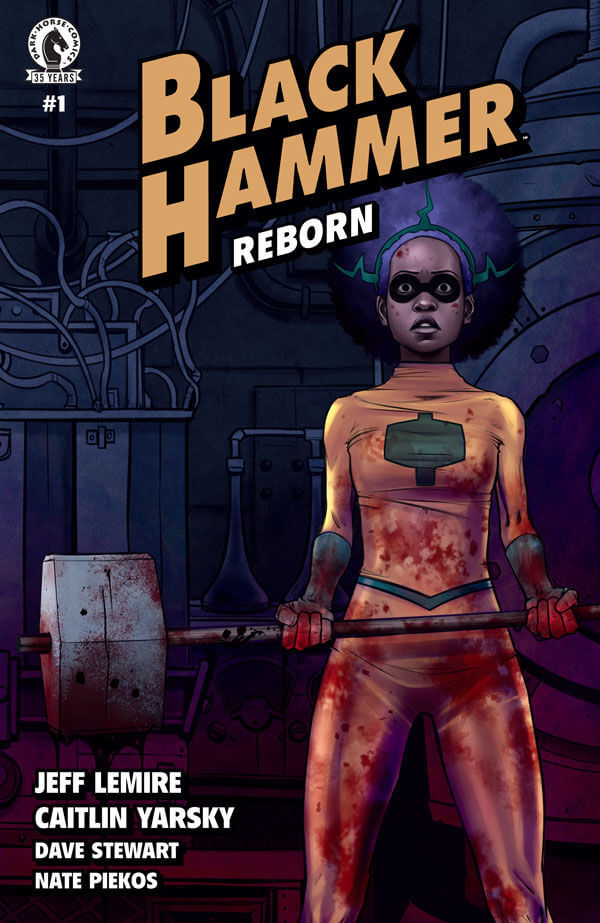 A costumed Black woman with a big afro holds a big hammer. She and the hammer are covered in blood and there is a look of shock on her face