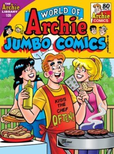 Archie Andrews, wearing an apron reading 'kiss the cook often' mugs for the camera as he stands between veronica lodge and betty cooper. He's covered with lipstick kisses and is in the middle of barbecuing