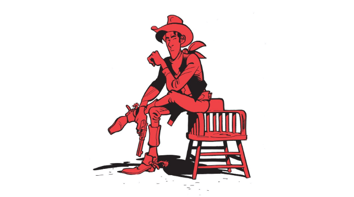 The cowboy Lucky Luke sits casually on a chair