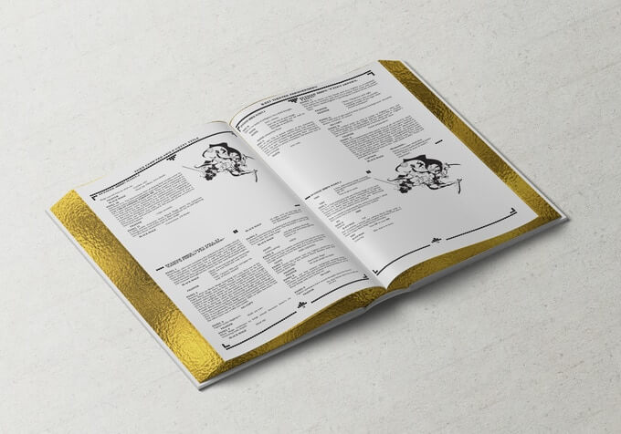 A spread from a mockup of the 8-bit Theater deluxe edition. The book is a large hardcover with four pages of scripts laid out on each page. The pages are gold-edged.