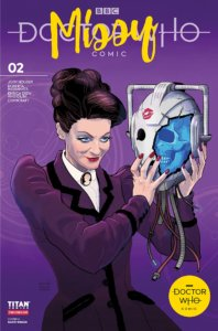 Missy, a white woman with dark hair and wearing Victorian garb, smiles while holding a robot head detached from its body. There is a lipstick mark on the robot head, suggesting she kissed it.