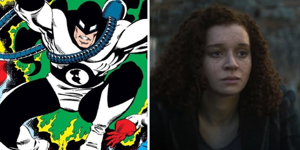 A comic masked villain beside a woman with curly hair