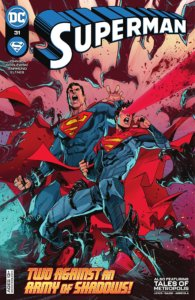 Superman and Superboy standing against aliens