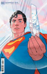 Superman holding a crystal in the fortress of solitude