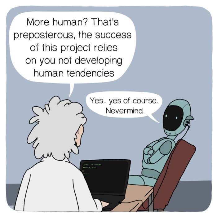 A robot sits on a chair in front of a scientist who is monitoring the robot on a computer