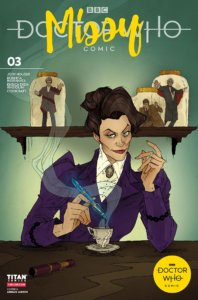 Missy, a dark haired White woman in Victorian dress, slyly smiles as she stirs a cup of tea with a sonic screwdriver. On the shelf behind her are several Doctors - - the Twelfth, Tenth, and Third -- in miniature in glass jars