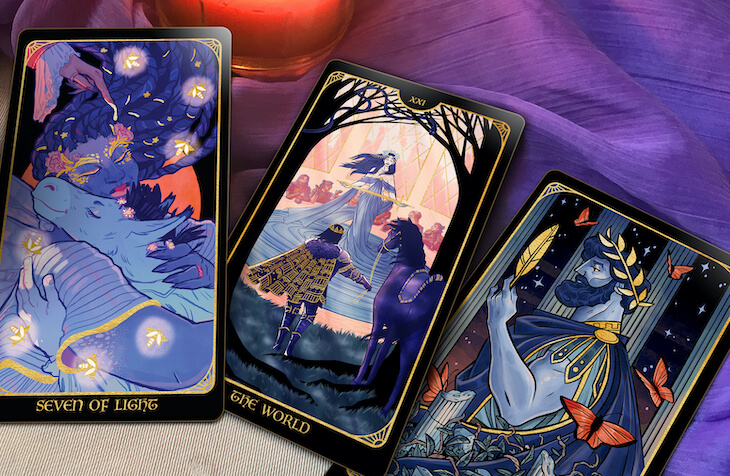 3 cards from the Literary Tarot: 7 of Light, the World, the King of Quills