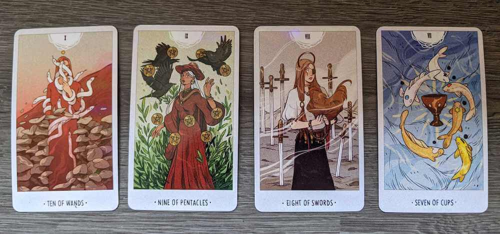 4 cards from the white numen tarot: 10 of wands, 9 of pentacles, 8 of swords, 7 of cups, all of which depict numen spirits