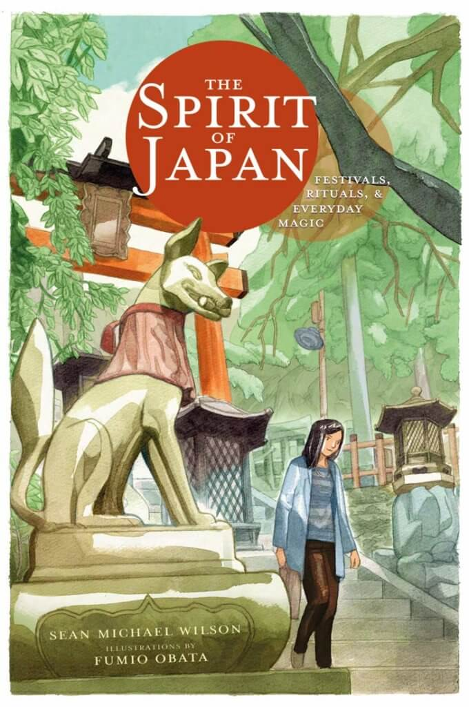 The cover of The Spirit of Japan, showing a woman walking down the steps at Fushimi-Inari shrine