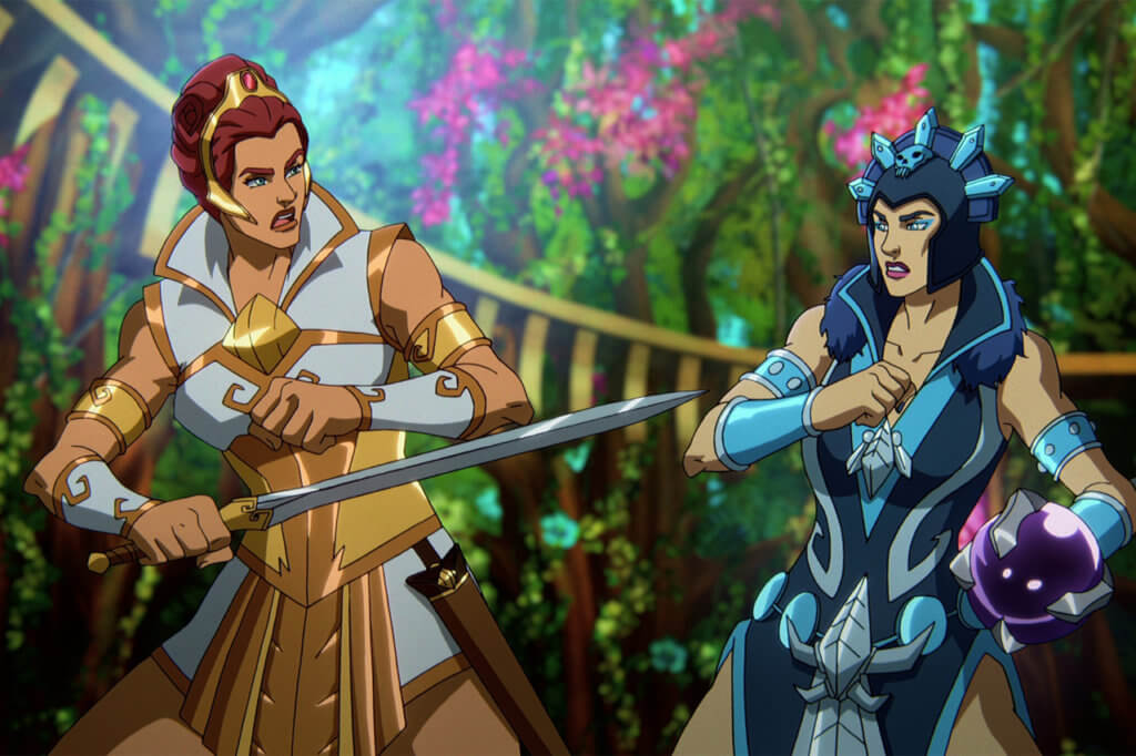 Teela, holding a sword, and Evil-Lyn, holding her staff, face off in battle