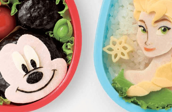 A close up of colorful bento dishes, these including representations of Mickey Mouse and Elsa from Frozen
