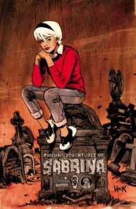 Sabrina Spellman - a white-haired white-skinned teenager with her hair cut short in a bob, sits upon a tombstone, her hands tucked contemplatively beneath her chin, and her knees resting upon her elbows, eyes upon the viewer. She's wearing a white peter-pan collared shirt, a red sweater with a black collar, and grey slacks rolled up at the ankles, with black and white saddle shoes on her feet. The background is rusty brown colored.