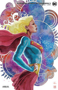 Supergirl standing arms on her hips in front of many planets