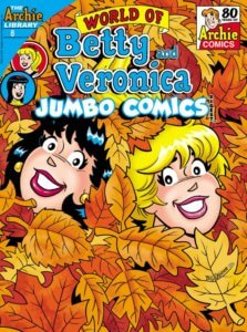 White Brunette and White Blonde teenagers Veronica Lodge and Betty Cooper lie submerged in a pile of orange-yellow leaves. You can only see the teenager's smiling faces and Veronica's small golden earrings