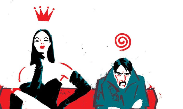 A tall woman in knee high black boots, panties, and a black corset and long gloves sits on a red couch beside a grumpy, slouching mustached man in a gray suit