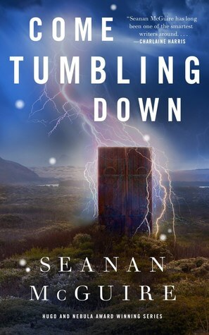 Cover of Come Tumbling Down by Seanan Mcguire. Cover image shows a door surrounded by magical lightning.