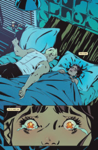 Full page internal art with a rectangular insert at the bottom. A girl with dark hair huddled under the covers and a blond boy laying on his stomach next to her. The closeup is of her eyes and fires have replaced her irises.